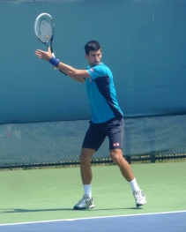Djokovic warming up for his match